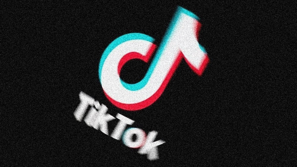 照片中提到了TikTok,包含了圖形、牆紙、商標、產品、照片