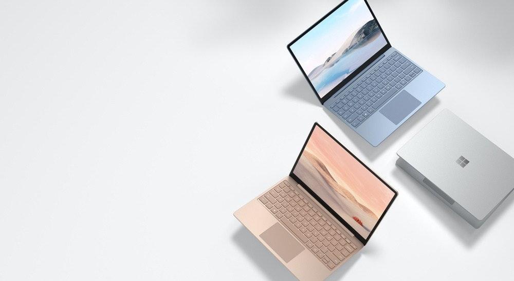 照片中提到了-,包含了表面筆記本電腦走、表面筆記本電腦走、Surface Pro X、微軟、英特爾酷睿i5