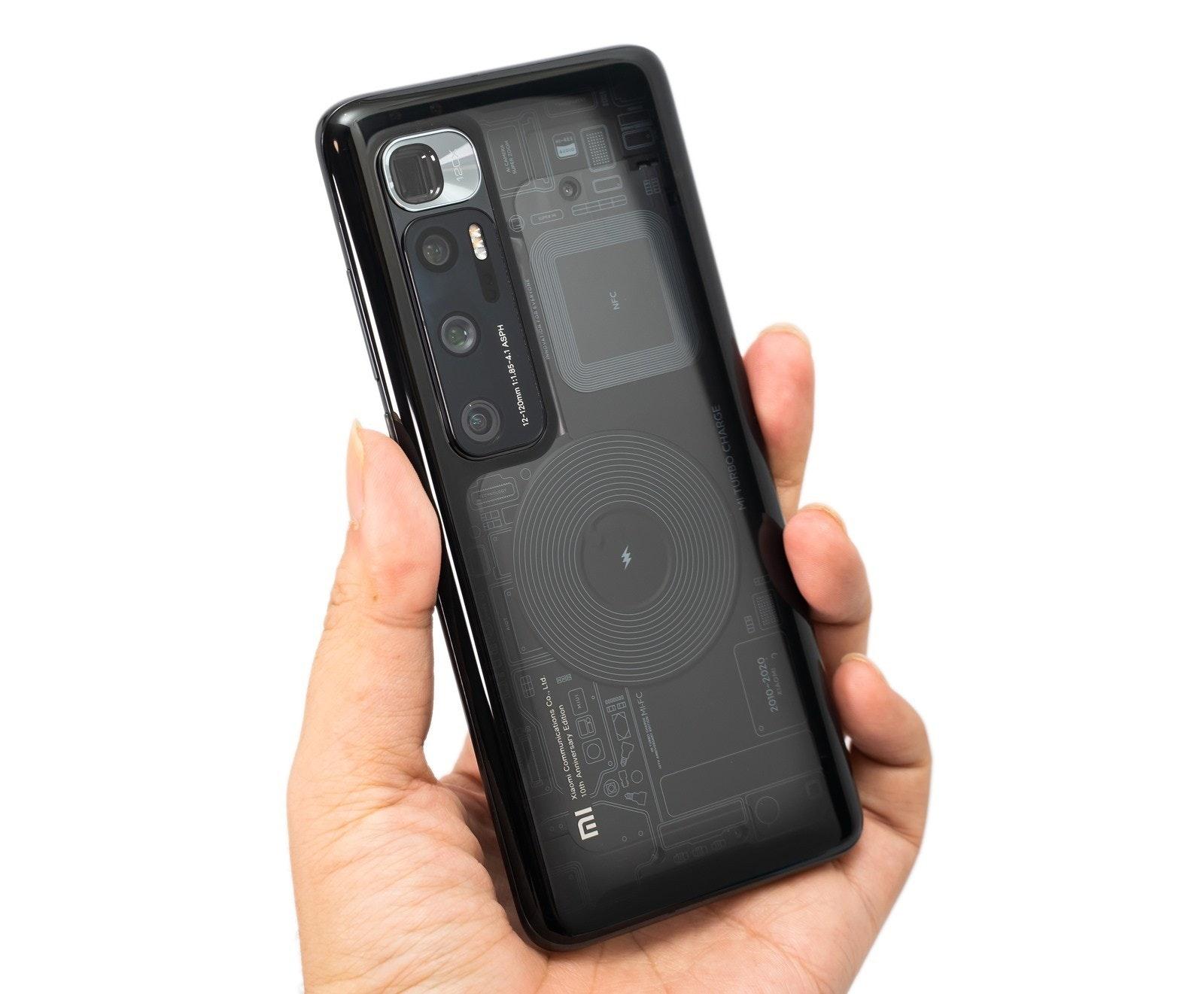 照片中提到了Xiaomi Communications Co., Ltd.、10th Anniversary Edition、12-120mm 1:1.85-4.1 ASPH,包含了功能手機、小米Mi 10 Ultra、手機、小米米10、便攜式通訊設備