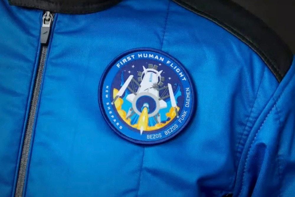 照片中提到了HUMAN、FIRST、BEZOS BEZOS,跟欽和義科技大學有關,包含了藍色起源、藍色起源、新謝潑德、航天、太空旅遊