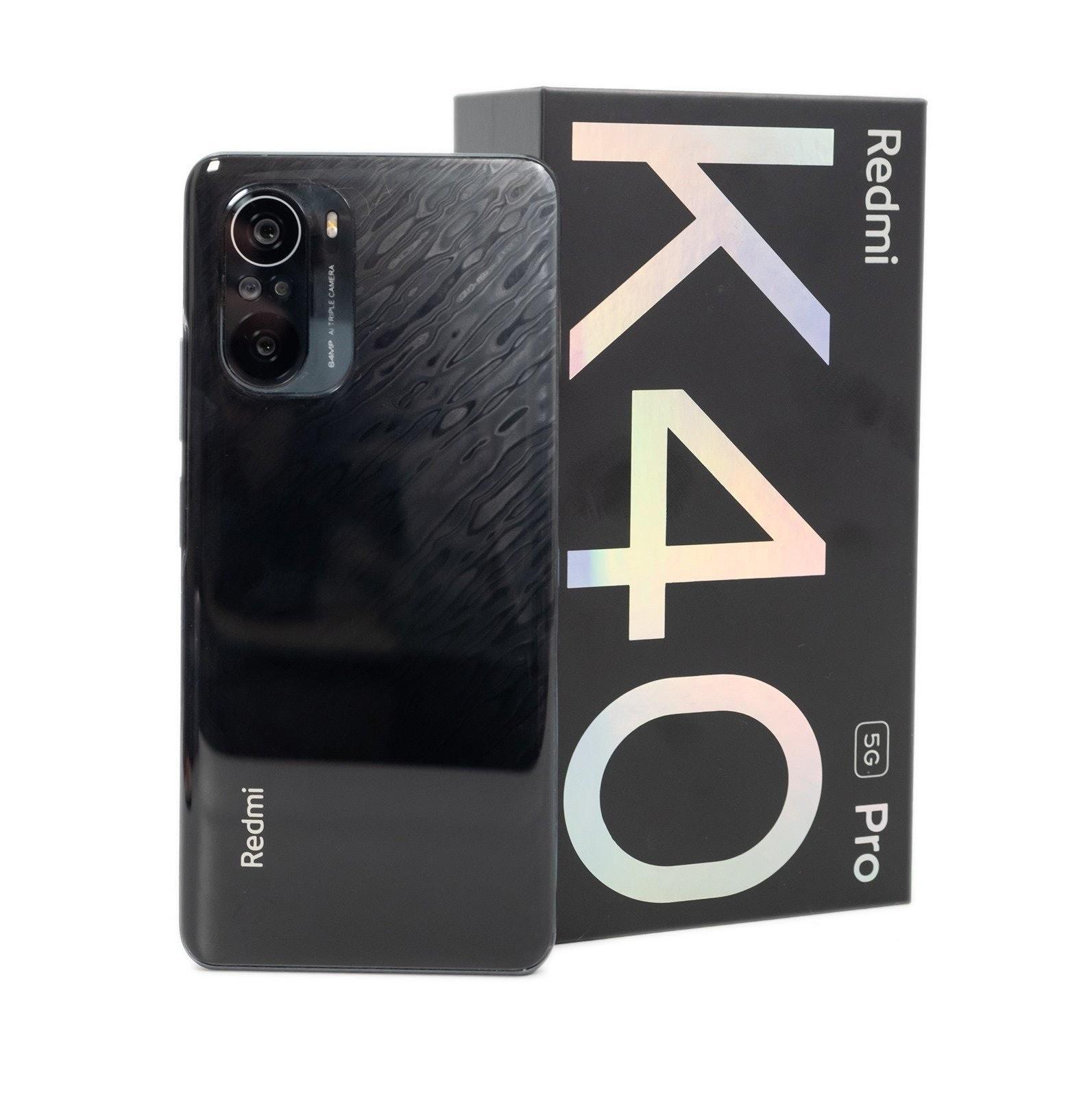 照片中提到了Redmi、Pro、5G,包含了移動電話、移動電話、手機配件、產品設計、電子產品