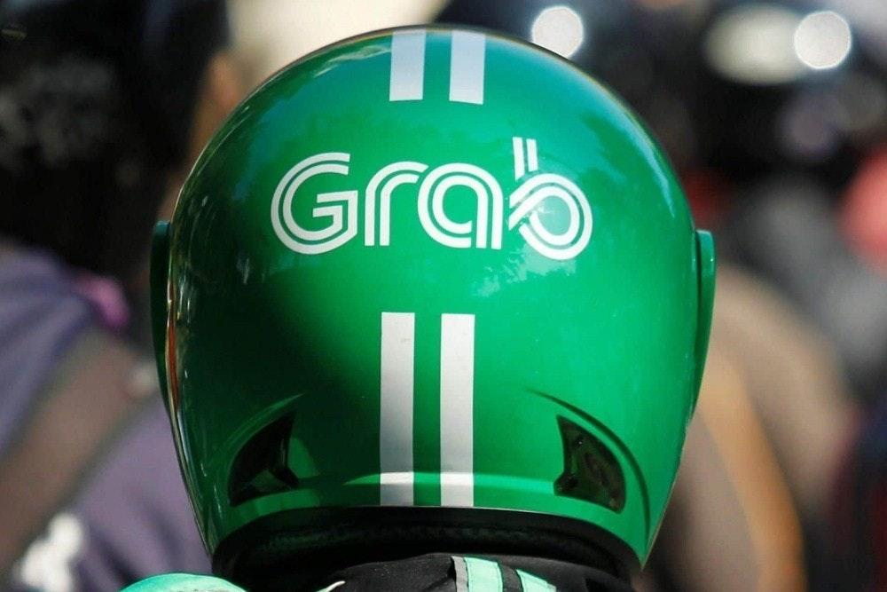 照片中提到了Grab,跟抓有關,包含了頭盔抓斗自行車、出租車、摩托車、摩托車出租車