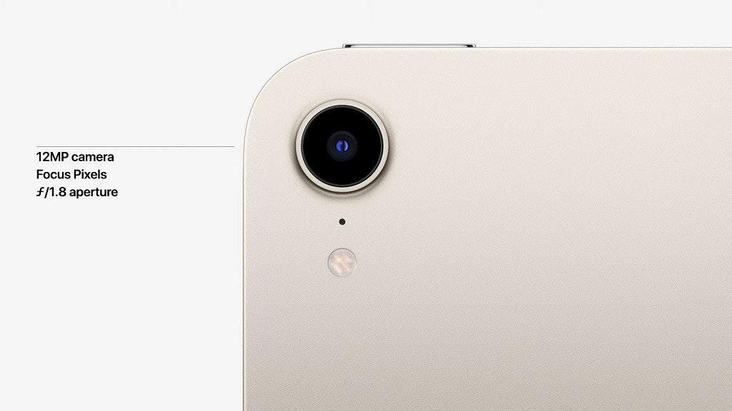 照片中提到了12MP camera、Focus Pixels、f/1.8 aperture,包含了手機、便攜式通訊設備、手機、蘋果、iPhone 13