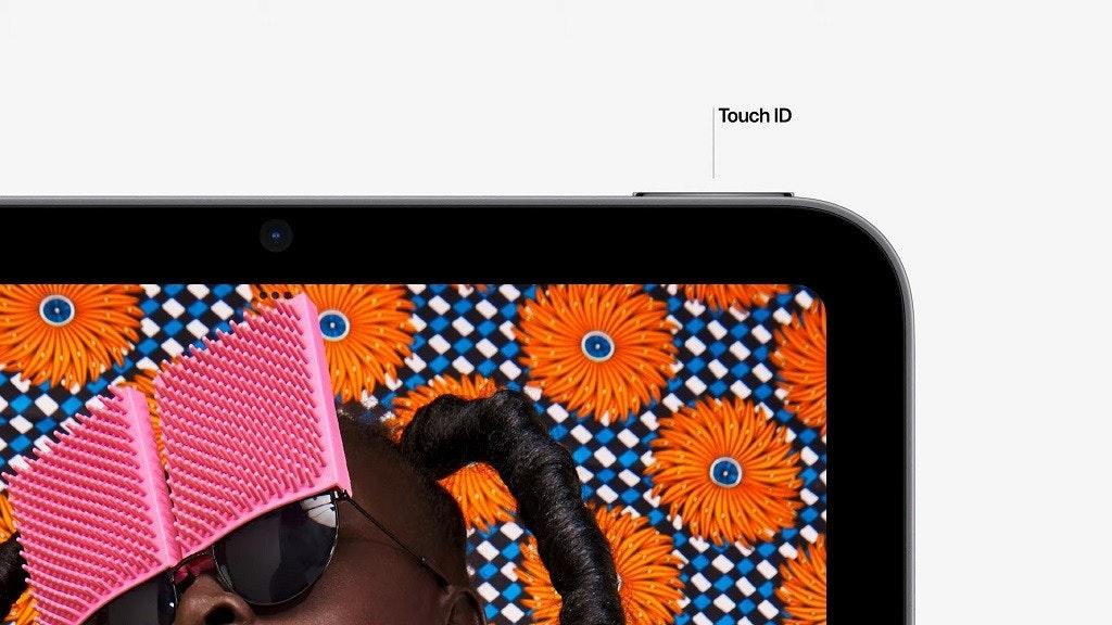 照片中提到了Touch ID,包含了橙子、蘋果、iPhone 13、手機、蘋果手機