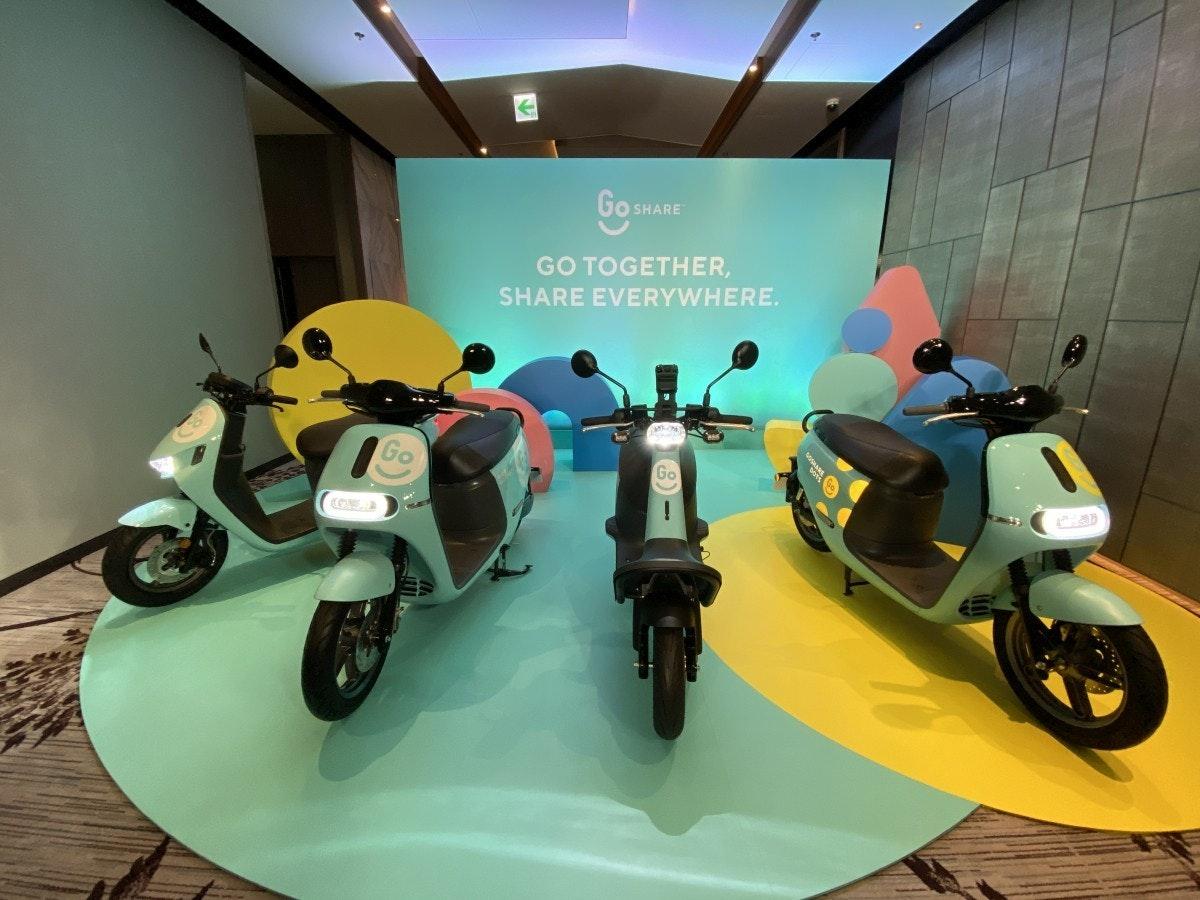 照片中提到了GO SHARE、GO TOGETHER,、SHARE EVERYWHERE.,包含了摩托車、摩托車、汽車、GoShare、五郎郎