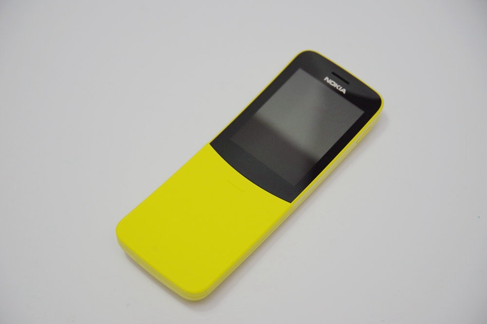 Feature phone, Smartphone, Product design, Product, Design, Mobile Phones, iPhone, feature phone, yellow, feature phone, mobile phone, electronic device, gadget, communication device, product, technology, portable communications device, product