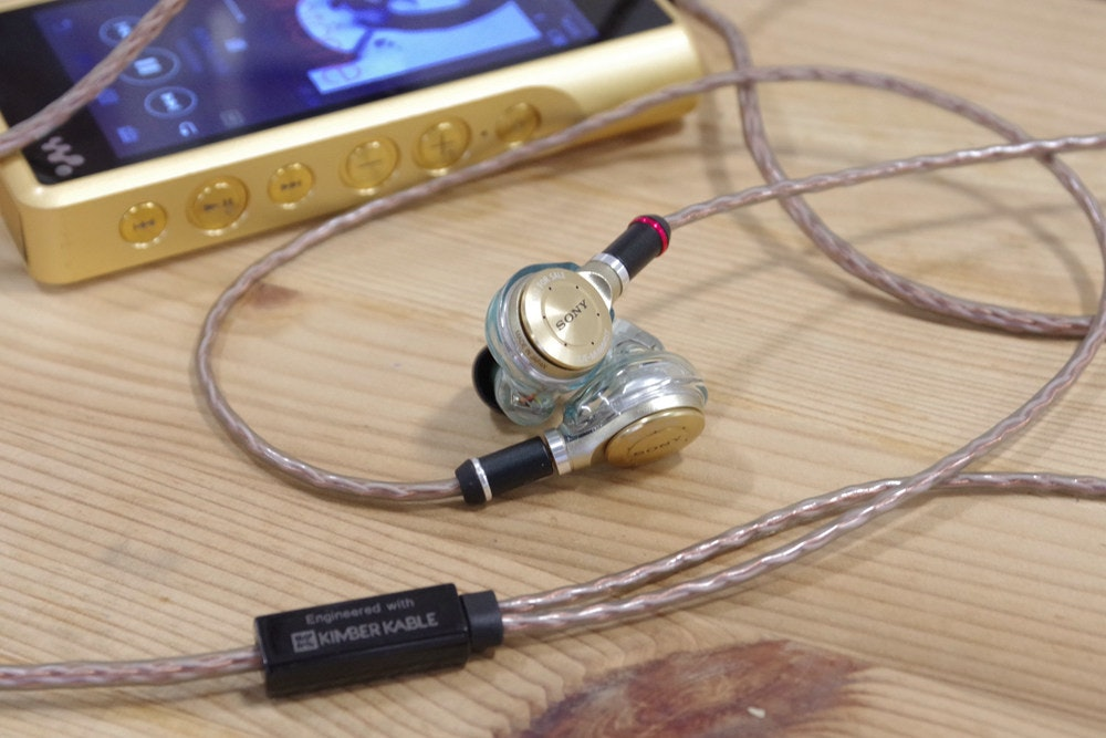 Electrical cable, Headphones, Wire, Close-up, cable, Electronic device, Audio equipment, Technology, Headphones, Wire, Cable, Electronics, Gadget, Font, Electronics accessory