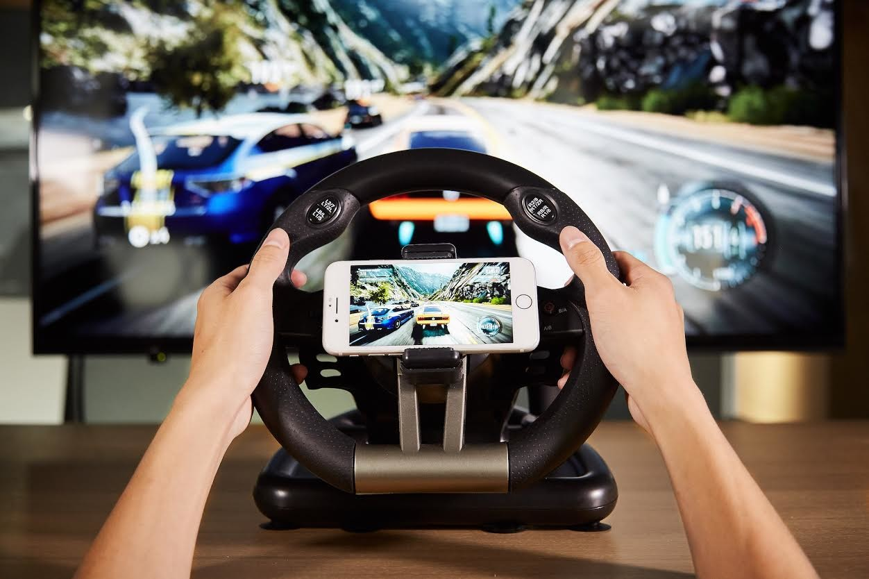 Car, Handheld Devices, Gadget, Automotive design, Electronics, Design, Mobile app, car, Technology, Gadget, Steering wheel, Steering part, Vehicle, Electronic device, Hand, Car, Driving, World