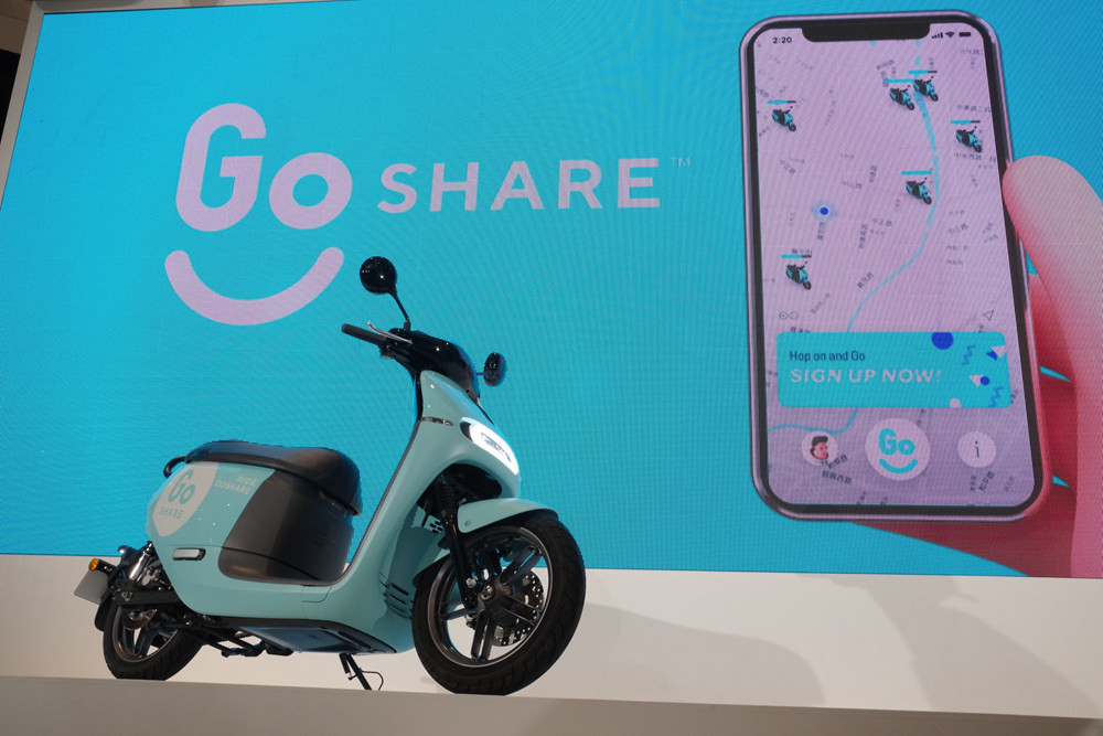 Gogoro, , Taoyuan, Car, Motorcycle, Motor vehicle, Gogoro Smartscooter, Sharing, Electric motorcycles and scooters, , go share, Motor vehicle, Scooter, Vehicle, Pink, Mode of transport, Turquoise, Automotive design, Design, Material property, Technology