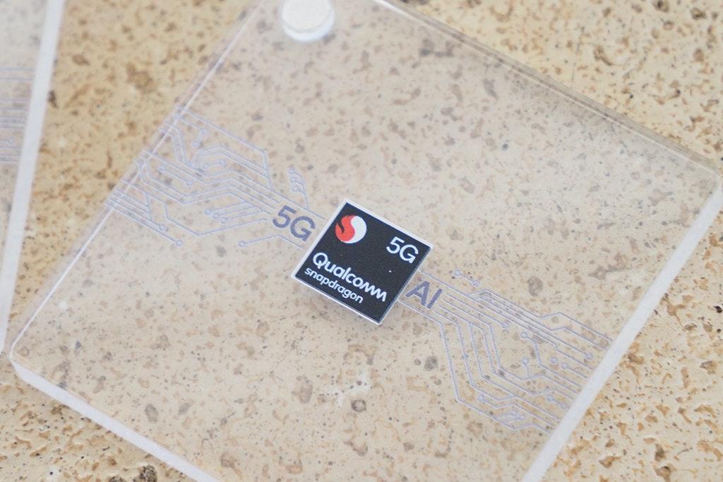 照片中提到了5G、5G、Qualcowm,跟信和集團有關,包含了地板、吉恩體育航空中心、地板、儀表、文字訊息