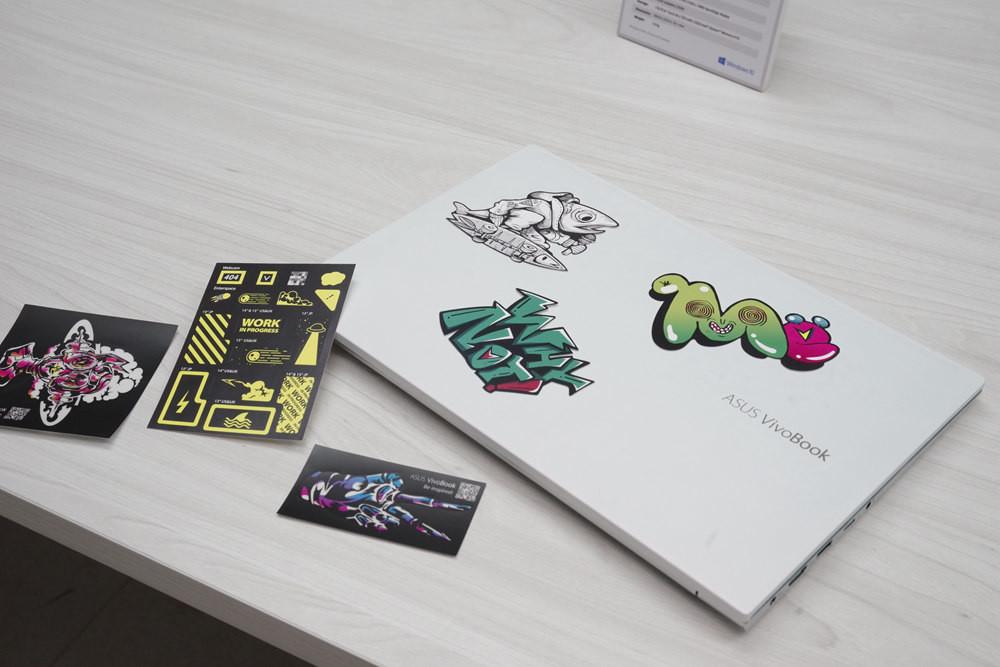 照片中提到了ASUS VivoBook、WORK、ASUS Viook,包含了設計、商標、設計、牌、產品設計