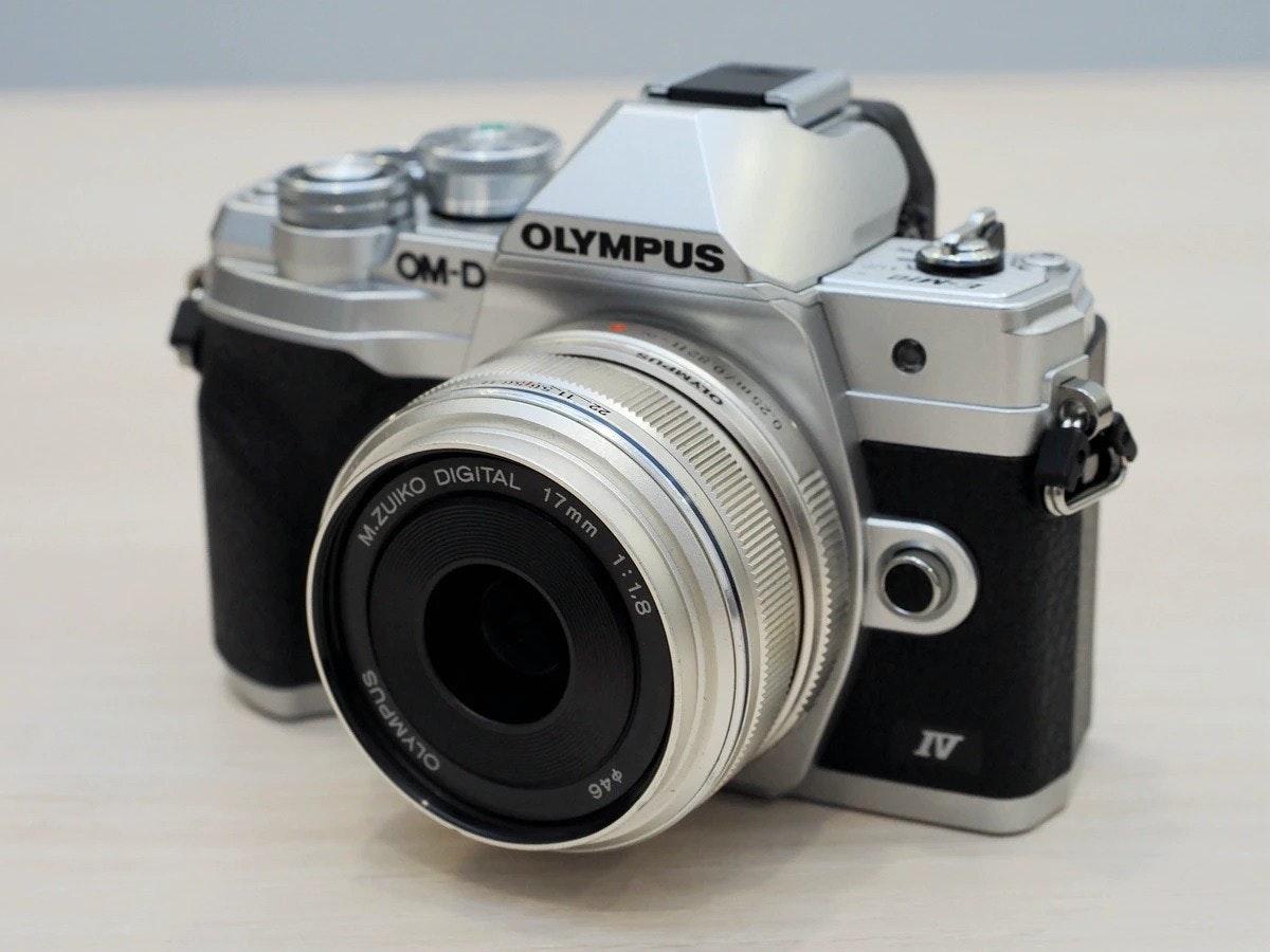 照片中提到了OLYMPUS、OM-D、OLYMP,跟奧林巴斯公司有關,包含了奧林巴斯、奧林巴斯OM-D E-M10、數碼單反、鏡頭、奧林巴斯OM-D E-M1