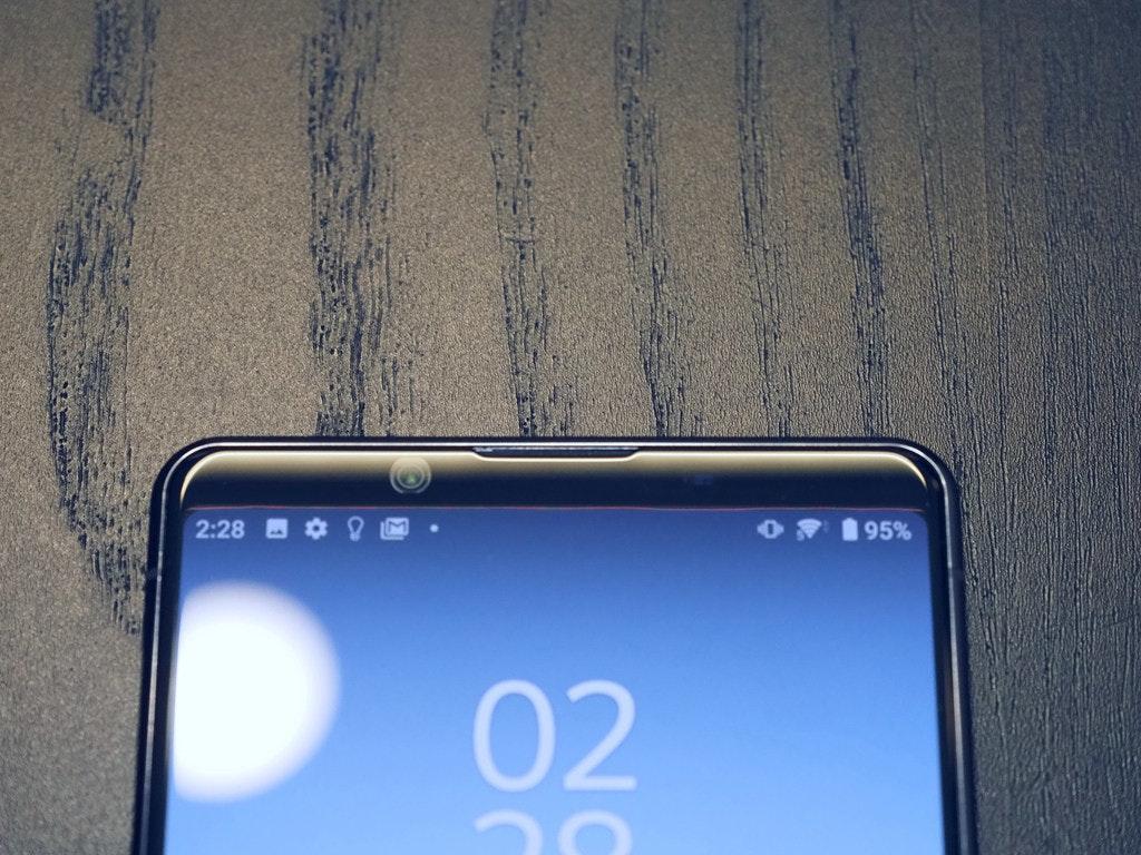 照片中提到了2:28、95%、02,包含了功能手机、功能手机、手机、显示设备、电子产品