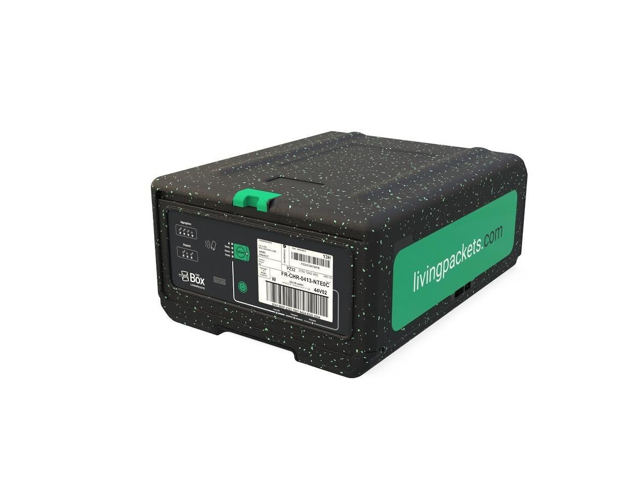 照片中提到了FR-CHR-0413-NTEOC、livingpackets.com、Böx,包含了硬件、電子墨水控股、消費電子展、後勤、包裝和標籤
