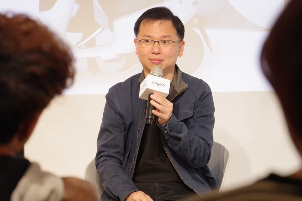 照片中提到了gogoro.,包含了公開演講、管理、商業、工作、公共關係