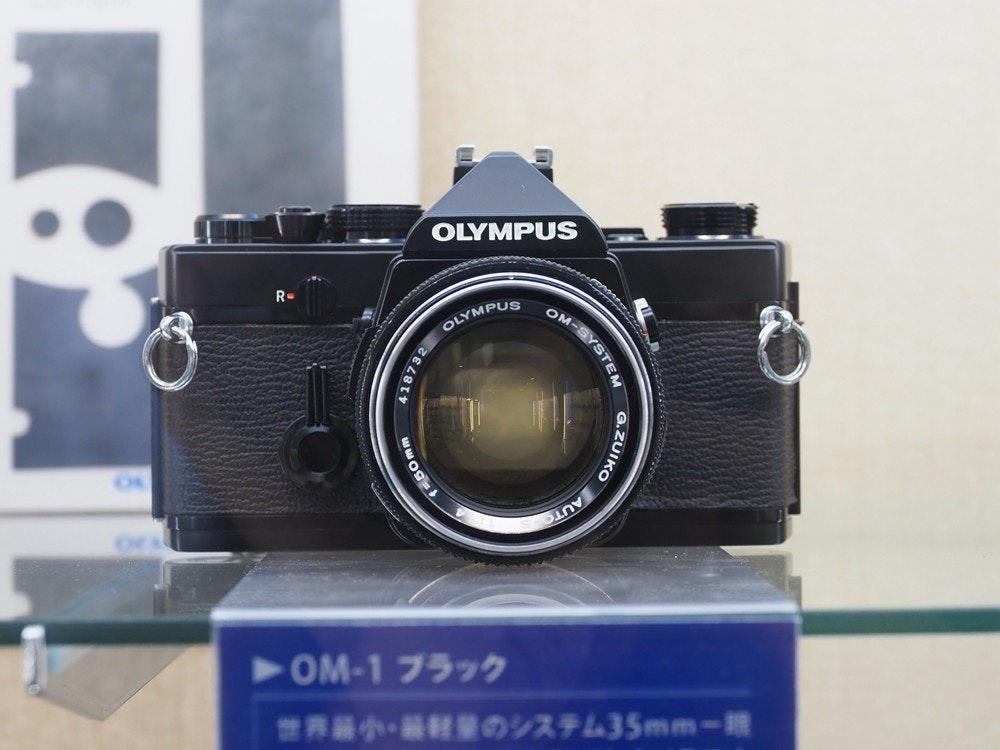 照片中提到了OLYMPUS、OM-SYSTE、OLYMPUS,包含了奧林巴斯、鏡頭、數碼單反、相機、奧林巴斯公司