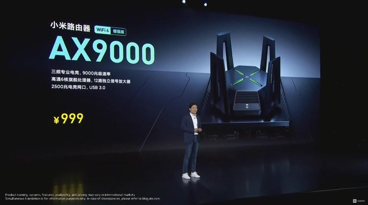 照片中提到了小米路由器WFi6增强版、AX9000、三频专业电竟, 9000兆级速率,包含了視覺效果、平面設計、屏幕截圖、牆紙、牌