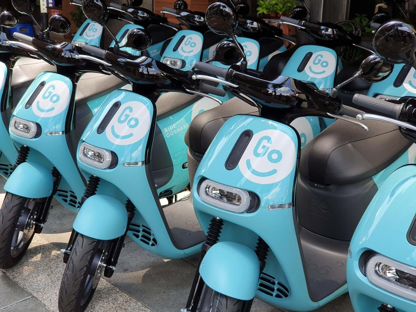 照片中提到了RIDE、GOSHA、Go,包含了goshare台北、汽車、摩托車、GoShare、電動摩托車和踏板車