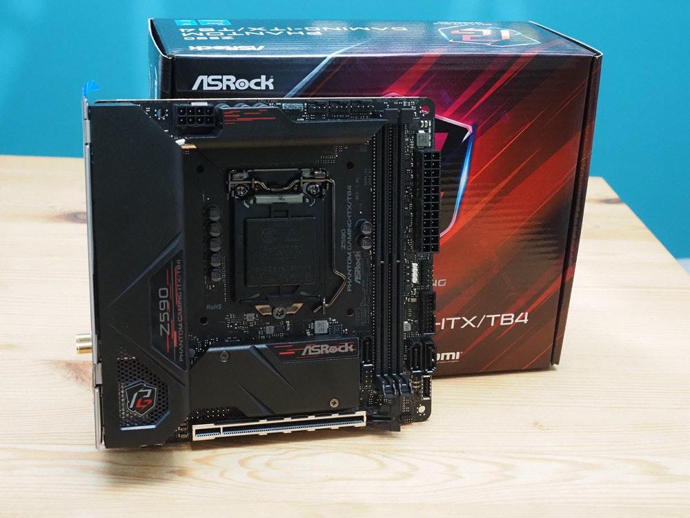 照片中提到了ASROCK、NG、ROHS,包含了電腦機箱、電腦機箱、電腦硬件、電子產品、電腦