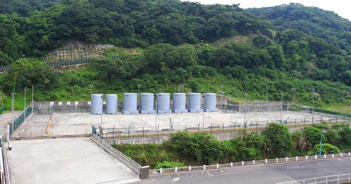 Jinshan Nuclear Power Plant, Dry cask storage, , Nuclear power, Taiwan Power Company, Nuclear power plant, Noble gas, Steel, Concrete, Reservoir, dam, Wall, Hill station, Infrastructure, Architecture, Tree, Reservoir, Road, Plant, Tourism, Dam
