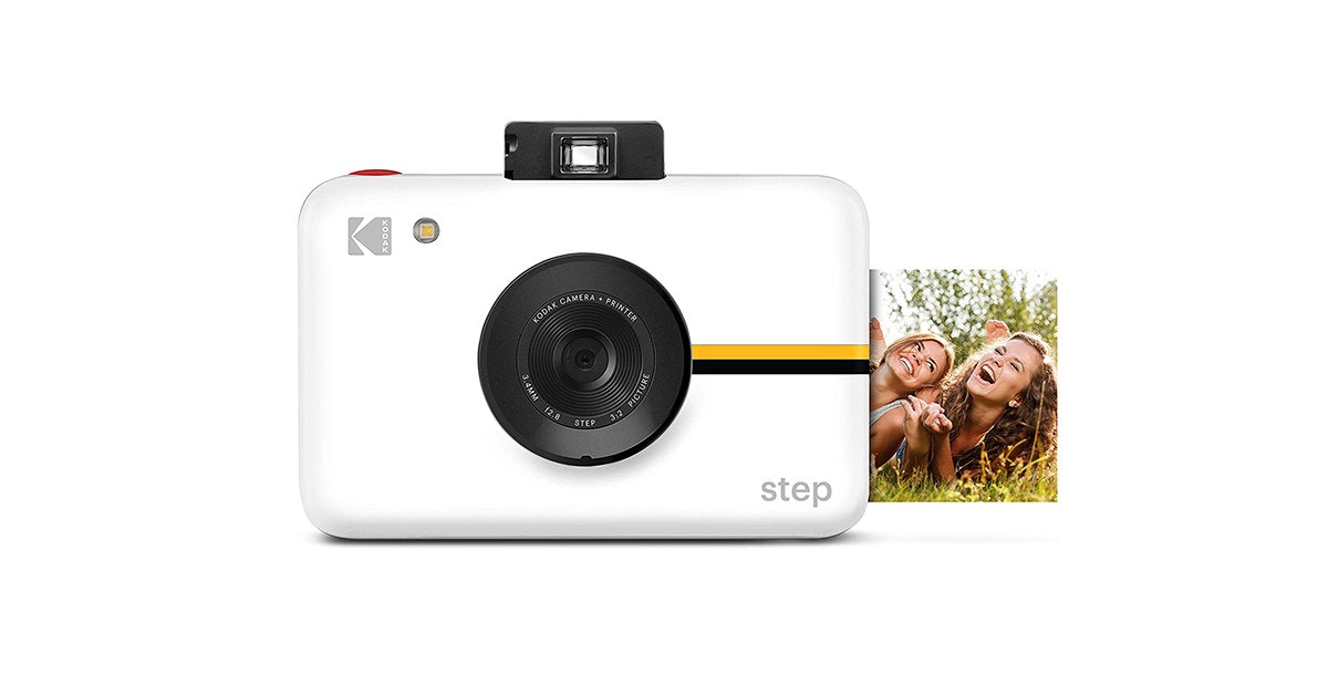 照片中提到了KI、PRINTER、ODAK CAMERA,包含了鏡頭、無反光鏡可換鏡頭相機、鏡頭、相機、產品設計