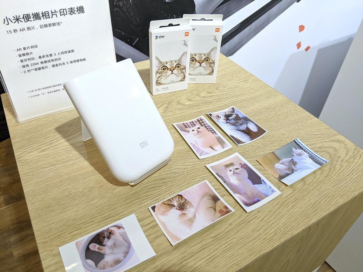 照片中提到了小米便攜相片印表機、15秒 AR 照片,記錄更鮮活。、* AR 影片列印,包含了表、產品設計、牌、儀表、設計