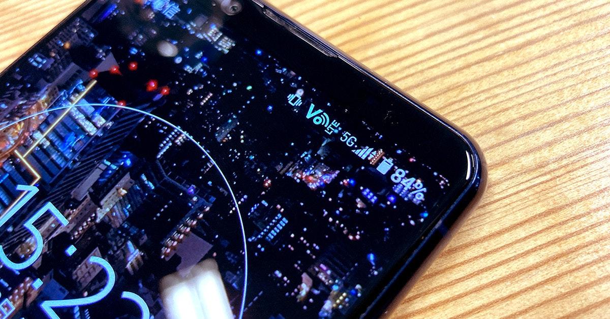 照片中提到了Vか 56浦音8%,包含了蜂窩網絡、移動設備、手機、蜂窩網絡、電腦硬件