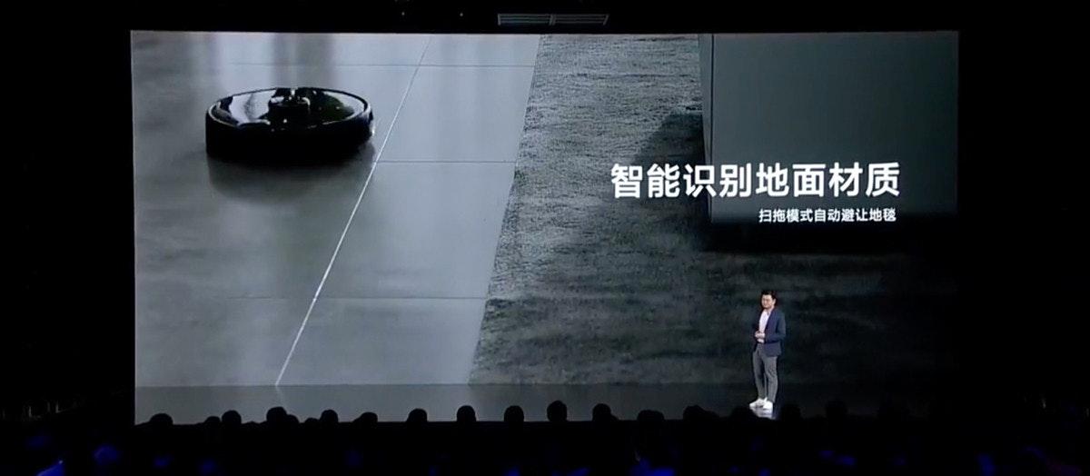照片中提到了智能识别地面材质、扫拖模式自动避让地毯,包含了光、光、黑暗、顯示裝置、屏幕截圖