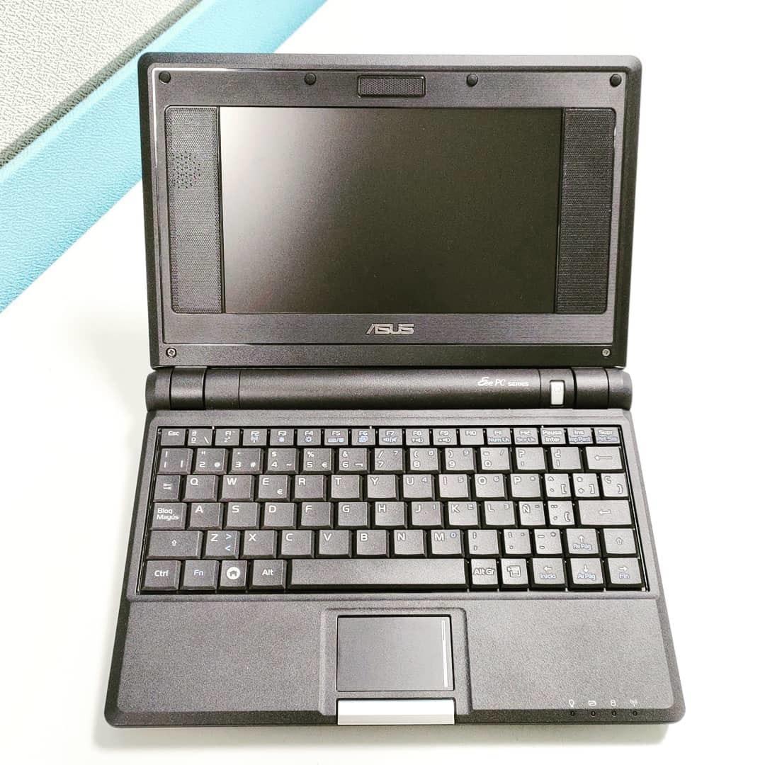 照片中提到了ASUS、Ee PC sees、Pausa,包含了筆記本正片主板、上網本、Positivo Mobo 5950、波西蒂沃、電腦硬件
