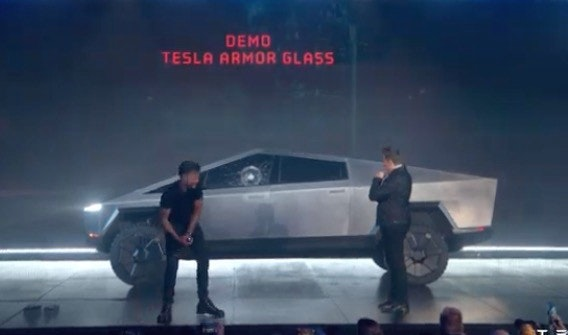 照片中提到了DEMO、TESLA ARMOR GLASS,包含了汽車、汽車、汽車設計、摩托車、現象