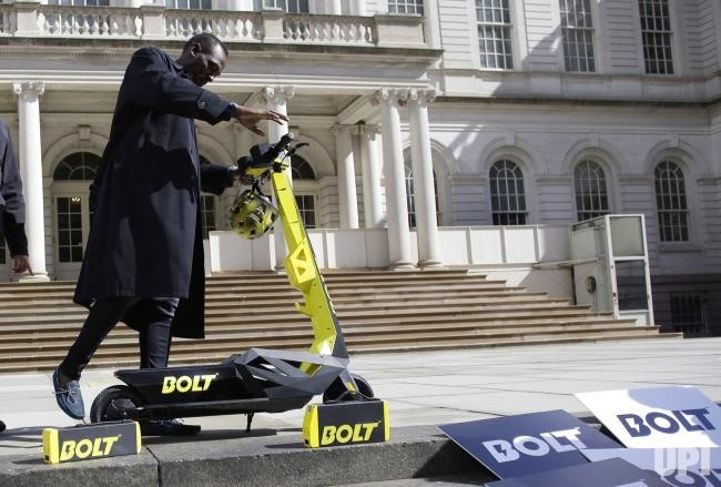 Motorized scooter, Kick scooter, Car, , Sprint, New York, Electric vehicle, Scooter, Sports, Olympic champion, usain bolt scooter, Street performance, Street, Vehicle, Advertising, Vacuum cleaner, Sidewalk