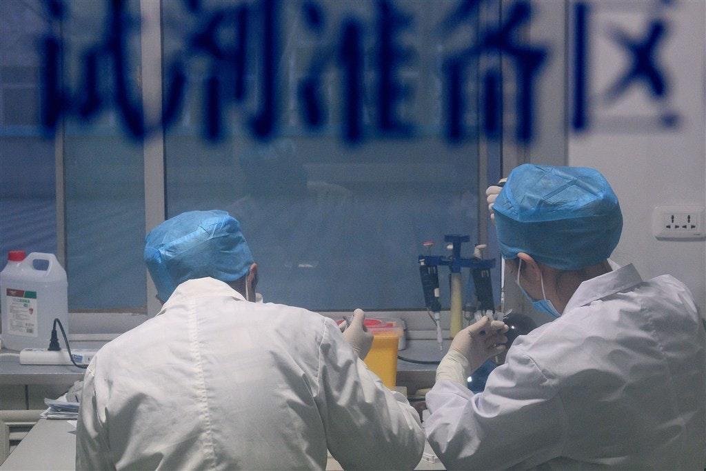照片中提到了试剂准备区,包含了水、2019–20年中國肺炎暴發、傳染病、隔離、流感