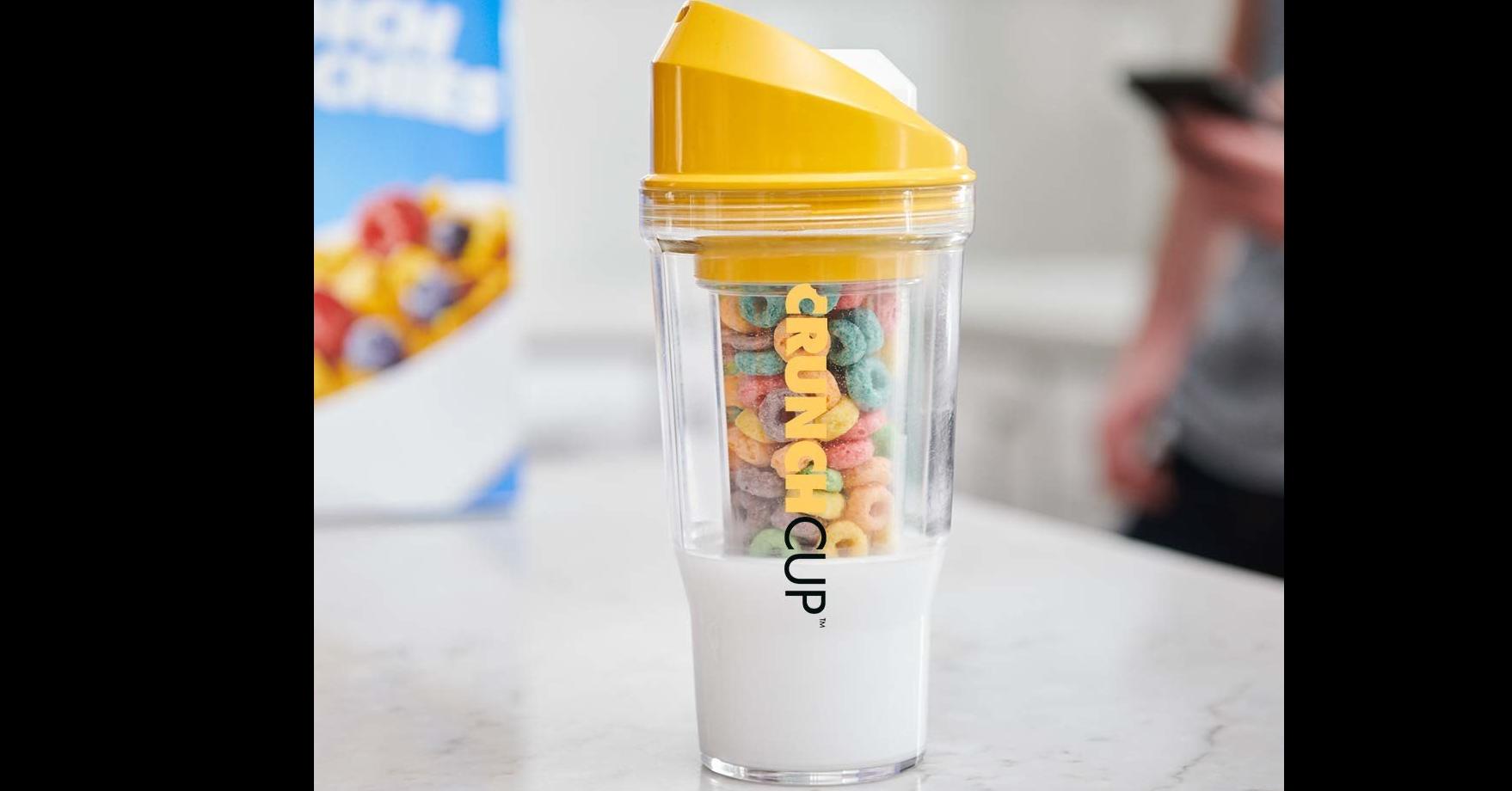 照片中提到了CHIE、CRUNCH CUP、TM,包含了一杯麥片、早餐麥片、早餐、牛奶、緊縮杯