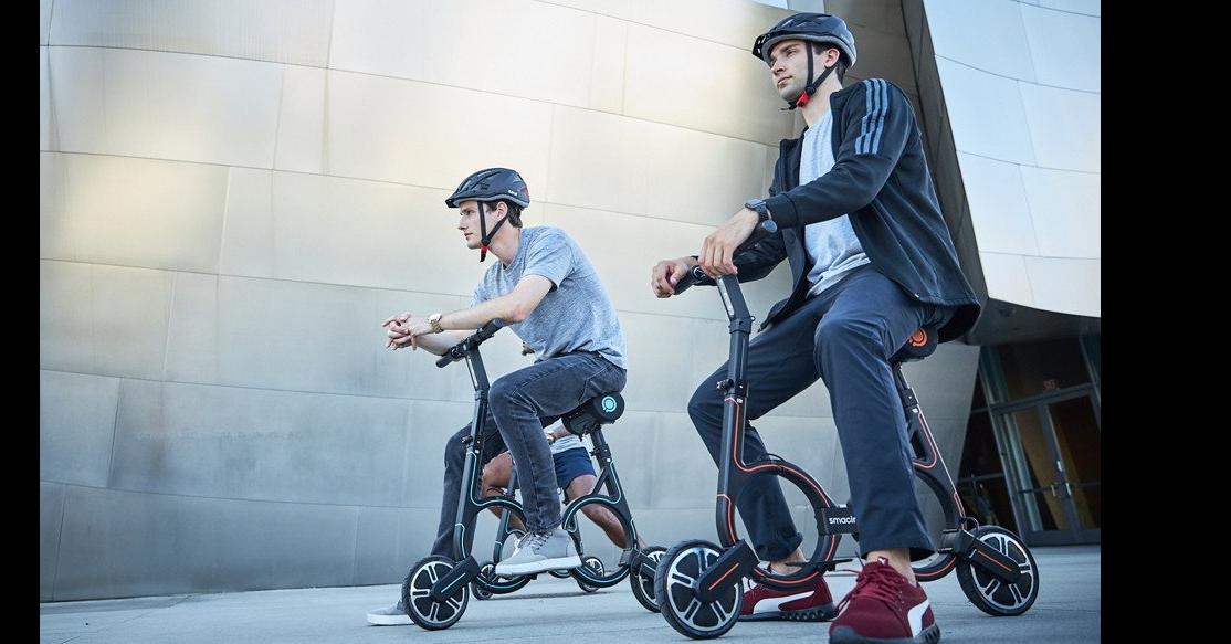 照片中提到了smacir,包含了圓環s1、自行車、S1 1號風格、摩托車、電動踏板車