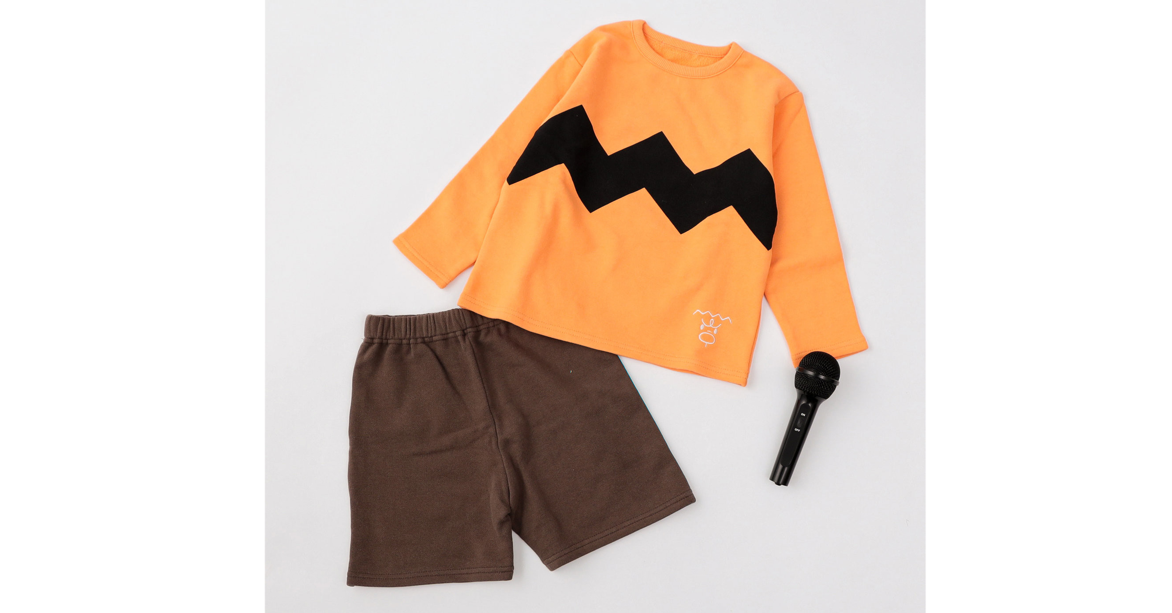 照片中包含了橙子、T恤衫、產品