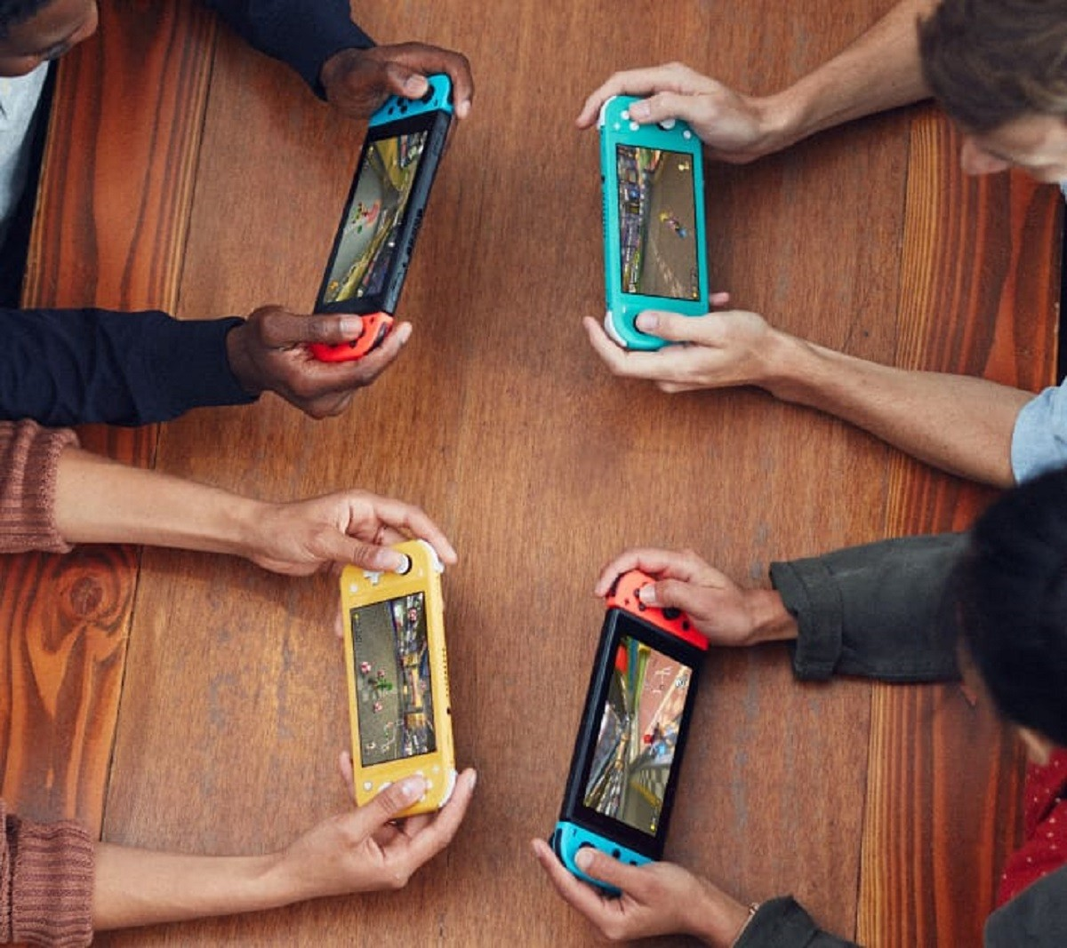 Nintendo Switch, Nintendo, , Video Games, Nintendo DS Lite, Handheld game console, Nintendo 3DS, Mega Man 11, Video Game Consoles, , hand, Gadget, Electronic device, Mobile phone, Technology, Portable communications device, Communication Device, Hand, Fun, Mobile device, Human