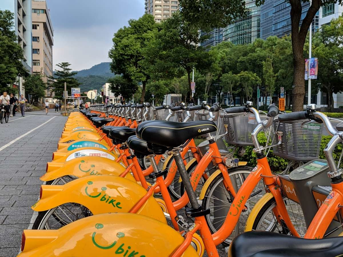 Road bicycle, YouBike, Car, Bicycle, Motorcycle, Bicycle-sharing system, Mountain bike, Cycling, Vehicle, Mountain, car, Bicycle, Motor vehicle, Orange, Vehicle, Yellow, Transport, Mode of transport, Cycling, Bicycle handlebar, Bicycle wheel