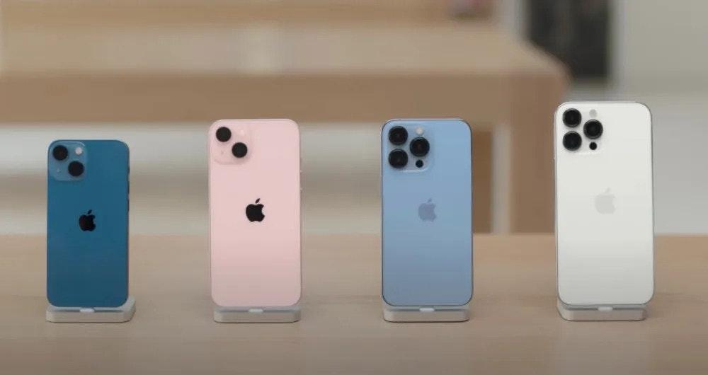 照片中包含了手機、手機、iPhone 13 專業版、蘋果、128GB 存儲空間